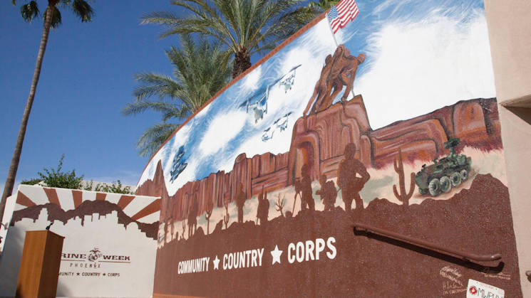 Marine Week Phoenix mural is unveiled in Scottsdale, Ariz., Sept. 12, 2015. Five Marine artists worked for nearly a week in temperatures upwards of 100 degrees to finish the mural celebrating relationships built during the week between the Corps and the people of Arizona. (U.S. Marine Corps photo by Sgt. Justin Boling)