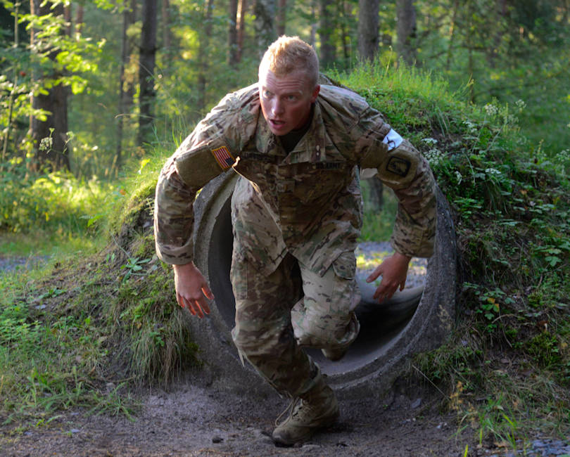 U.S. Army 2nd Lt. Davis Hayden, assigned to the 12th Combat Aviation Brigade, overcomes an obstacle during the 2016 European Best Warrior Competition held at the 7th Army Training Command's Grafenwoehr Training Area, Germany, Aug. 8, 2016. The intense, grueling annual week-long competition is the most prestigious competitive event of the region. Event organizers will announce the year's top junior officer, noncommissioned officer and Soldier during a concluding ceremony scheduled for Aug. 11 at the Grafenwoehr Physical Fitness Center. (U.S. Army photo by Pfc. Emily Houdershieldt)
