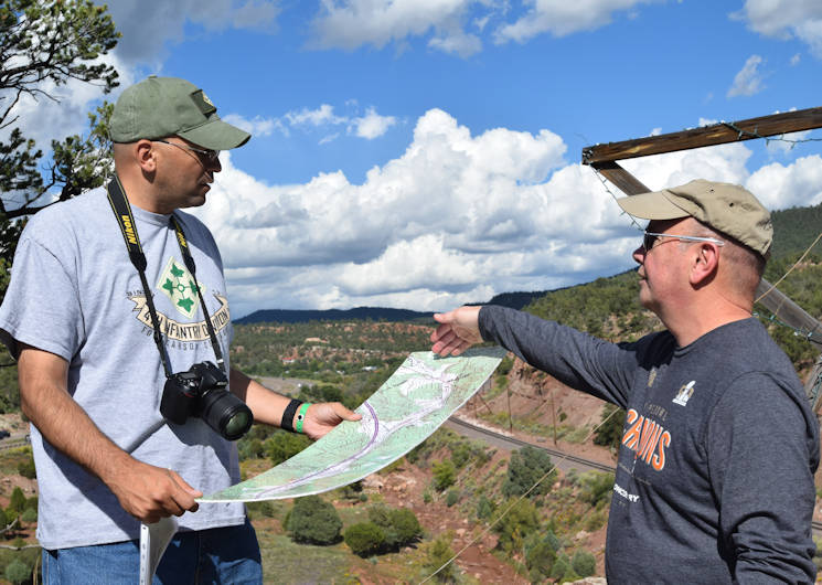 September 16, 2016 - Senior Advisor to the Army National Guard U.S. Army Lt. Col. Shannon Espinoza, left, and Chief Warrant Officer 4 John Mudlo, right, a Colorado Army National Guard Soldier, discuss key aspects of the Apache Canyon terrain during the Colorado National Guard staff ride to Glorieta Pass, NM. (U.S. Air National Guard photo by U.S. Air Force Lt. Col. Elena O'Bryan)