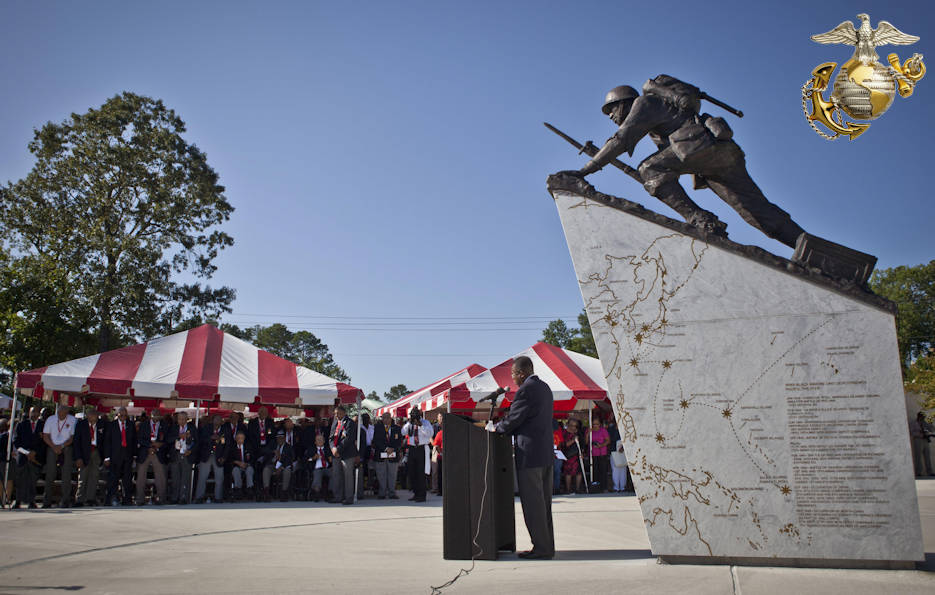 July 29, 2016 - U.S. service members and guests listen to the National Chaplain of the Montford Point Marine Association, Reverend James E. Moore, as he delivers the invocation during the Montford Point Marine Memorial dedication ceremony held at Jacksonville, North Carolina. The memorial was built in honor of the 20,000 African-Americans who attended training at Montford Point during World War II. (Image created by USA Patriotism! from U.S. Marine Corps photo by Cpl. Laura Mercado)