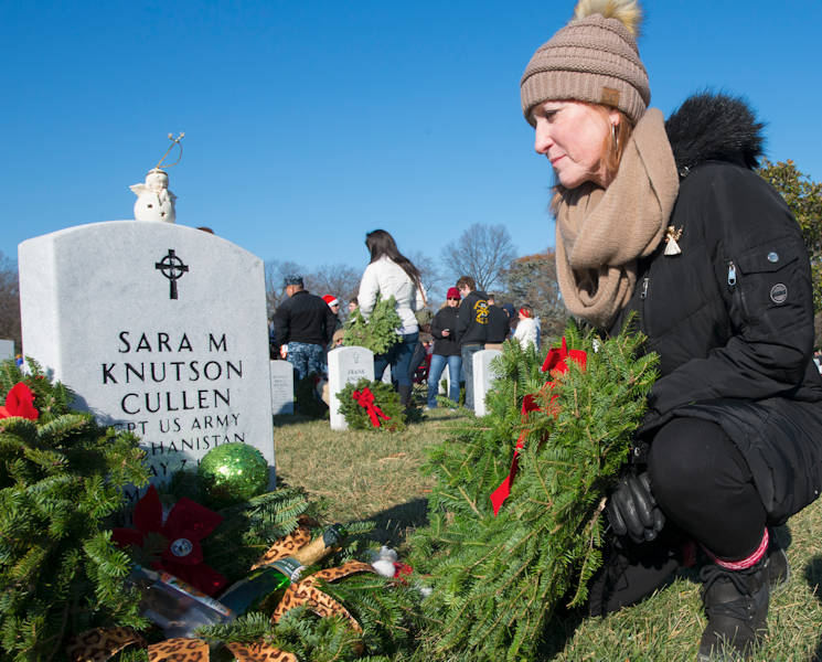 December 16, 2017 - Nancy Davis, mother-in-law of Capt. Sara Knutson Cullen, a Black Hawk pilot who was killed in Afghanistan, places a wreath on her headstone at Arlington National Cemetery, VA. More than 200,000 wreaths were placed on headstones as part of the annual Wreaths Across America event, which honors the sacrifices made by military members. (U.S. Army photo by Sean Kimmons)
