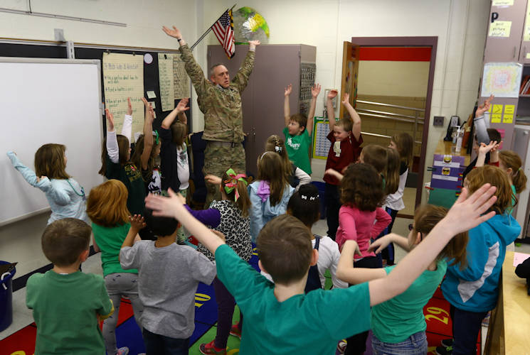March 17, 2017 - U.S. Army Sgt. 1st. Class Edward Swiger, a 20-year veteran for the 20th Chemical, Biological, Radiological, Nuclear and Explosives Command, and a group of 2nd-graders from Churchville Elementary School, stretch after Swiger read to them one of his favorite books, the 'FM 7-22' also known as the 'Army Physical Training Manual' during Celebrity Reading Day. The event was part of the school's Reading Month festivities. (U.S. Army photo by Angel D. Martinez-Navedo)