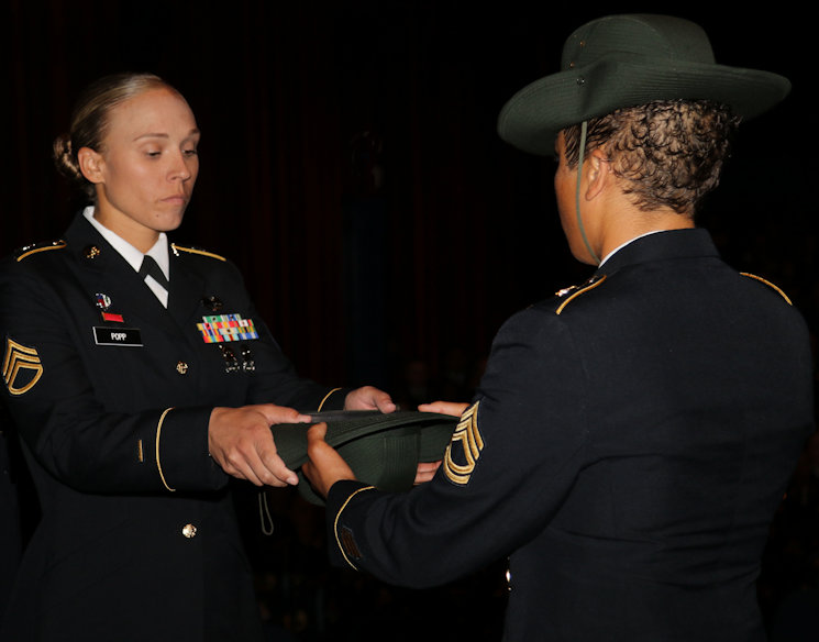 March 8, 2017 - Army Reserve Staff Sgt. Briana Popp takes her drill sergeant hat from senior drill sergeant leader Sgt. 1st Class Tanya Polk, during a graduation ceremony at Fort Jackson, S.C Popp earned the titles of Iron Female and Distinguished Honor Graduate and will be a drill sergeant with the 98th Training Division (Initial Entry Training). Popp, who is a Columbus, Ga. resident, was the first female Distinguished Honor Graduate in the past six cycles and happened to graduate in March, which is Women's History Month. Coincidentally, Popp's graduation day was International Women's Day as well. (U.S. Army Reserve Photo by Maj. Michelle Lunato)