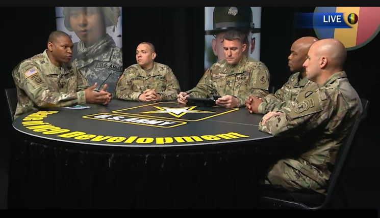 March 30, 2017 - Command Sgt. Maj. Michael Gragg, far left, with the Center for Initial Military Training, discusses the Expert Action Badge during a virtual town hall hosted by the Army Training and Doctrine Command. If approved, Soldiers would compete in 30-plus warrior tasks and battle drills, as well as up to five mental tasks, for a chance to wear the badge on their uniforms, similar to the Expert Infantryman Badge or Expert Field Medical Badge. (U.S. Army courtesy photo)