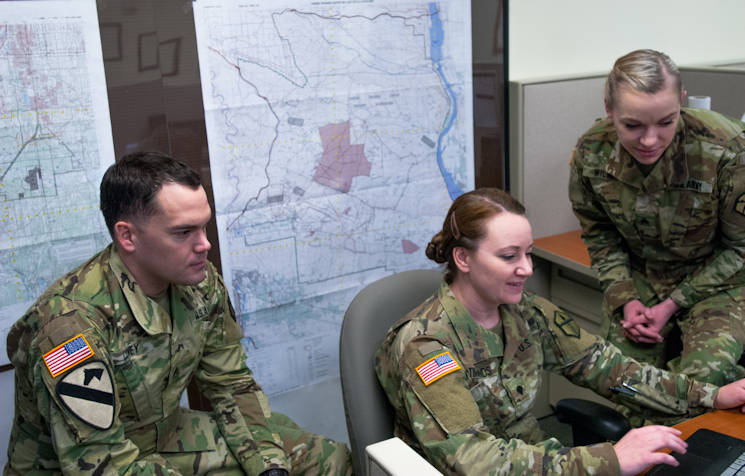 February 12, 2017 - From left: U;S. Army Sgt. Morgan T. Wilken, Spc. Tara M. McTimmonds, Sgt. Noel A. Covey, work together to produce a Combined Obstacle Overlay, Joint Base Lewis-McChord, Wash. Geospatial engineers produce the maps that will support the commander's next mission, and are a vital component of the Army, Army Reserve, and Total Force (U.S. Army Reserve photo by Spc. Sean Harding)