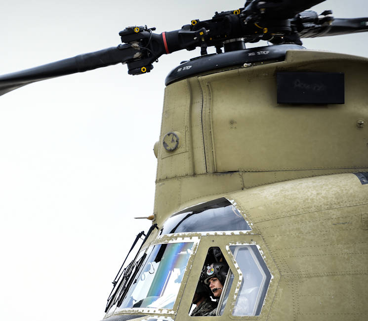 February 24, 2017 - U.S. Army Chief Warrant Officer Natalie Miller, Detachment 1, Company B, 2-238th General Support Aviation Battalion, sits in the pilot seat of her CH-47F Chinook heavy-lift cargo helicopter in Greenville, SC before leaving with her crew for a week-long training mission focused on high-altitude flight operations. She and her crew will attend a power management-centered course at the High-Altitude ARNG Aviation Training Site (HAATS), Eagle County, CO. (U.S. Army National Guard photo by Staff Sgt. Roberto Di Giovine)