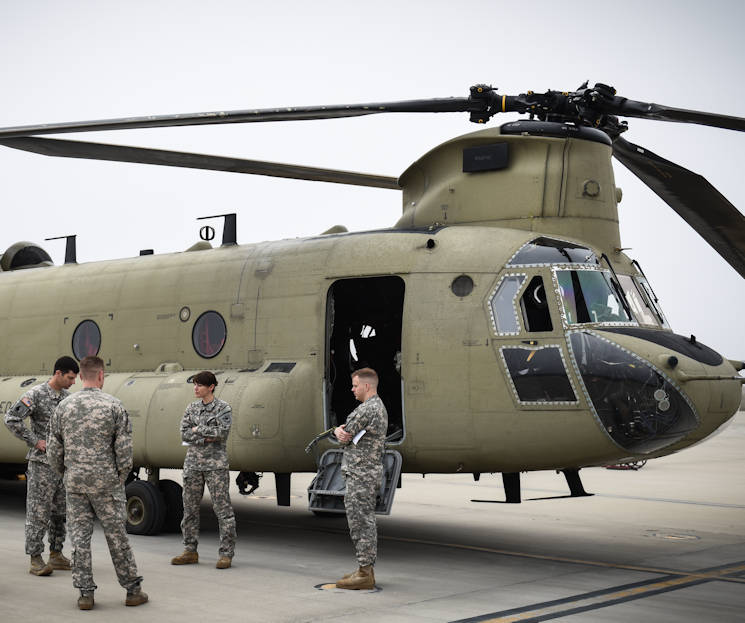 February 24, 2017 - U.S. Army Chief Warrant Officer Natalie Miller, Detachment 1, Company B, 2-238th General Support Aviation Battalion, stands with her back to a CH-47F Chinook heavy-lift cargo helicopter that she pilots ... as she meets with fellow South Carolina National Guard members in Greenville, SC ... before leaving with her crew for a week-long training mission focused on high-altitude flight operations. She and her crew will attend a power management-centered course at the High-Altitude ARNG Aviation Training Site (HAATS), Eagle County, CO. (U.S. Army National Guard photo by Staff Sgt. Roberto Di Giovine)