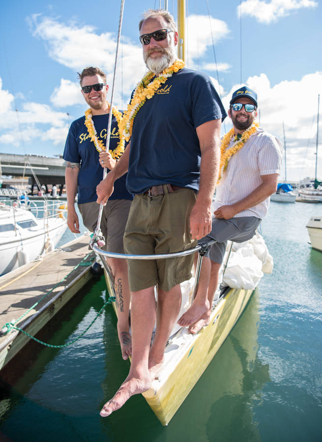 "July 27, 2017 - (L-R) Navy Chief Petty Officer Brian Bugge, Chris Ryder and Beau Romero on their sailboat ""Stay Gold"" after sailing from Washington State to Pearl Harbor, Hawaii. Brian Bugge was promoted to Ensign Limited Duty Officer on August 1, 2017. (U.S. Navy photo by Mass Communication Specialist 1st Class Daniel Hinton)"