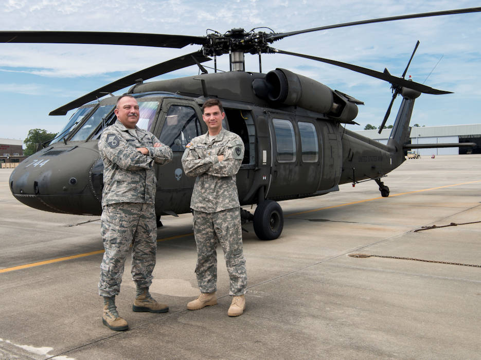June 13, 2017 - U.S. Army 2nd Lt. Michael Snyder (right) with A Co. 1-111th General Support Aviation Battalion and his father, U.S. Air Force Senior Master Sgt. Edward Snyder with the 169th Fighter Wing enjoy a Father's Day visit a few days early, while standing in front of a UH-60 helicopter at McEntire Joint National Guard Base in Eastover, South Carolina. (U.S. Army National Guard photo by Spc. Chelsea Baker)
