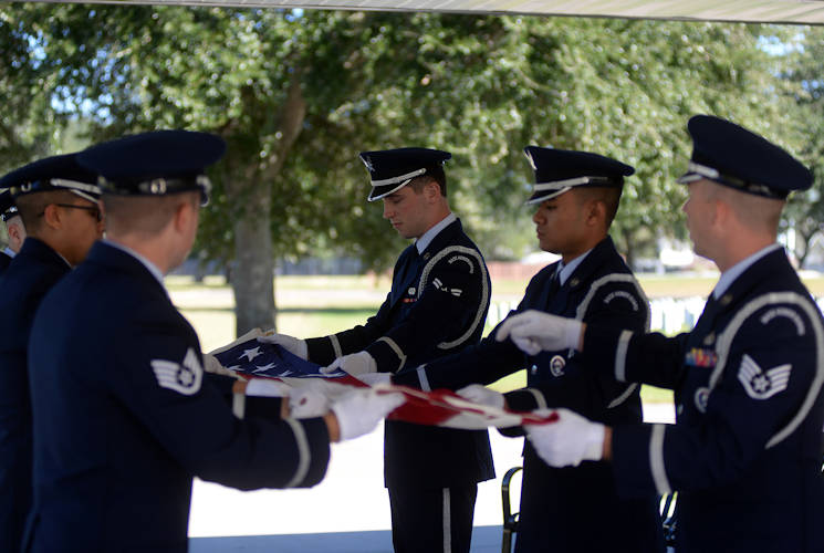 October 26, 2017 - Keesler Air Force Base Honor Guard members practice flag folding procedures before a funeral ceremony at the Biloxi National Cemetery in Biloxi, Mississippi. Every month the Keesler Honor Guard participates in a monthly funeral ceremony at the Biloxi National Cemetery to honor the unaccompanied remains of military members. (U.S. Air Force photo by Airman 1st Class Suzanna Plotnikov)