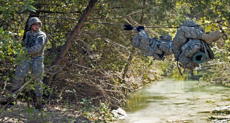 October 28, 2017 - Baylor University cadets cross a stream during the one-rope bridge lane during the warrior task event of the Ranger Challenge competition held at Fort Hood, Texas. (U.S. Army photo by Capt. Grace Geiger)