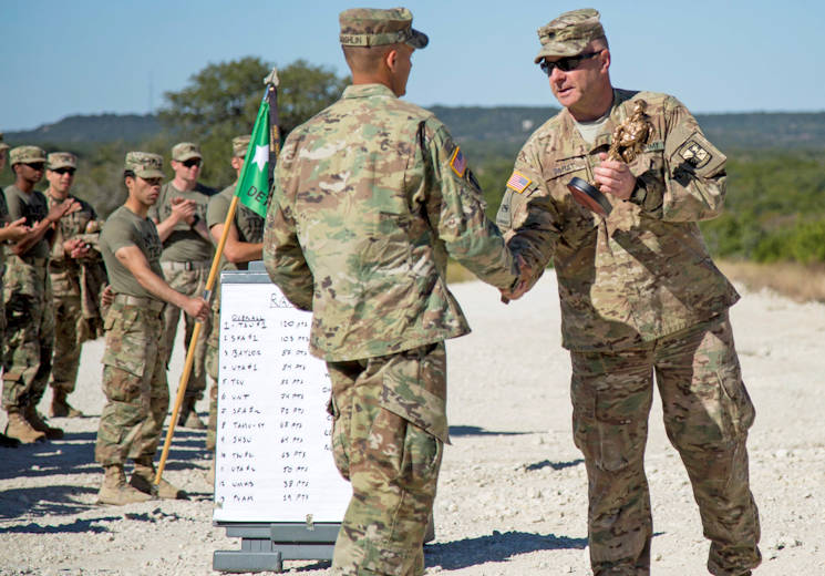 October 29, 2017 - Lt. Col. Steven Tabat, the professor of military science at Texas Christian University, hands the first place trophy to Cadet Austin Laughlin, a Tarleton State University junior, during the ROTC Ranger Challenge awards ceremony at Fort Hood, Texas. (U.S. Army photo by Capt. Grace Geiger)