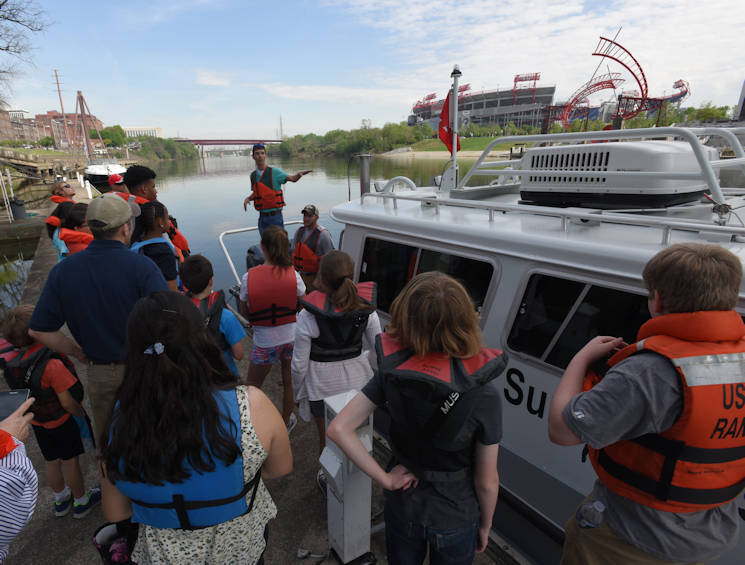 "April 14, 2017 - Civil Engineers Noel Smith and Cody Flatt talk about hydrographic surveying with kids who boarded the district's navigation survey boat as part of the district's ""Take Your Kids to Work Day"" activities at Riverfront in Nashville, TN. (U.S. Army Corps of Engineers photo by Leon Roberts)"