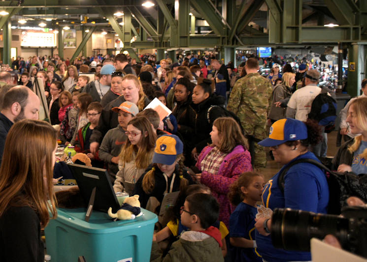 April 6, 2017 - Southeastern Wisconsin students and teachers line up at Wisconsin Emergency Management's booth during the Brewers' Science Fair, part of Weather Day at Miller Park in Milwaukee. Wisconsin Emergency Management, part of the state Department of Military Affairs, interacted with thousands of children for Weather Day, a program designed to educate youth about weather hazards and how to be prepared in the event of a weather emergency. (Wisconsin Department of Military Affairs photo by U.S. Army Sgt. Katie Eggers)