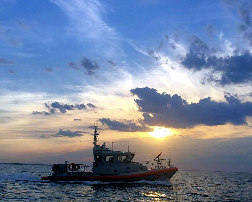 A U.S. Coast Guard Station Little Creek's Response Boat Medium (RBM) underway at sunset during tactical training on the Chesapeake Bay, Maryland in October 2018. Training for tactical operations allows the Coast Guard to carry out escorts and maintain defensive perimeters of critical infrastructure. (U.S. Coast Guard photo by Petty Officer MK2 Zachary Hood - released January 24, 2019)