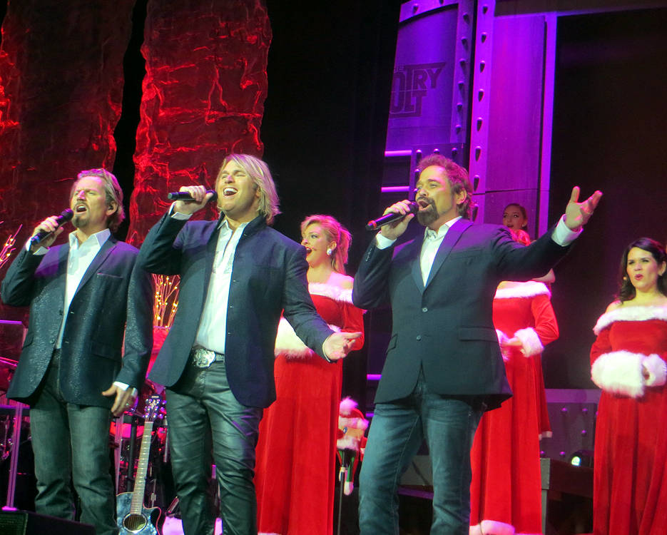 The Texas Tenors ... (L-R) JC Fisher, Marcus Collins, and John Hagen ... an Emmy Award winning classical crossover trio ... perform a heartfelt Christmas song with backup singers during their very entertaining musically diverse 2017 holiday season show at the Starlite Theatre in Branson, Missouri. (Photo by USA Patriotism!)