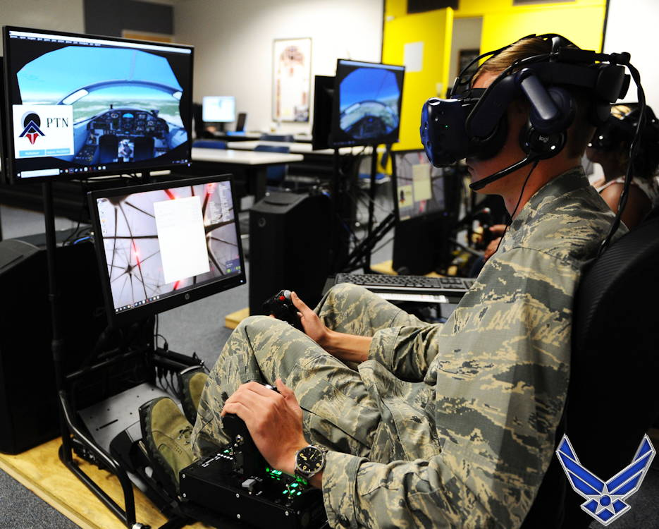 June 25, 2019 - U.S. Air Force Academy Cadet 1st Class Cade Cavanagh uses an immersive training device during a Pilot Training Next course at the U.S. Air Force Academy airfield. The Academy and Air Education and Training Command hosted training sessions to explore the benefits of exposing students to aviation skills using virtual reality technology. (Image created by USA Patriotism! from U.S. Air Force Academy photo by Jennifer Spradlin)