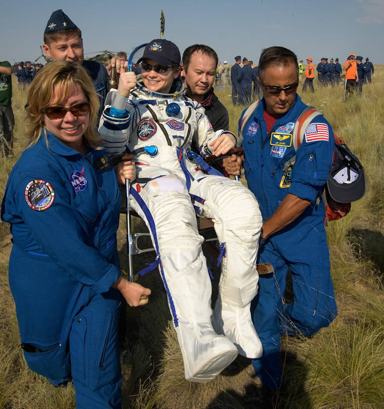 Expedition 59 astronaut Anne McClain of NASA is carried to a medical tent shortly after she, Canadian Space Agency astronaut David Saint-Jacques, and Roscosmos cosmonaut Oleg Kononenko landed in their Soyuz MS-11 spacecraft near the town of Zhezkazgan, Kazakhstan on June 25, 2019 Kazakh time (June 24 USA Eastern time). McClain, Saint-Jacques, and Kononenko are returning after 204 days in space where they served as members of the Expedition 58 and 59 crews onboard the International Space Station. (NASA photo by Bill Ingalls)
