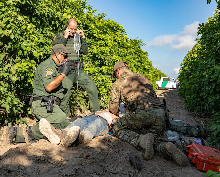 U.S. Border Patrol agents render medical aid to a migrant who illegally entered the U.S. in the Rio Grande Valley near McAllen, Texas on June 13, 2019. The migrant was transported to a local hospital by ambulance for further treatment. (U.S. Customs and Border Protection photo by Mani Albrecht, Office of Public Affairs - Visual Communications Division)