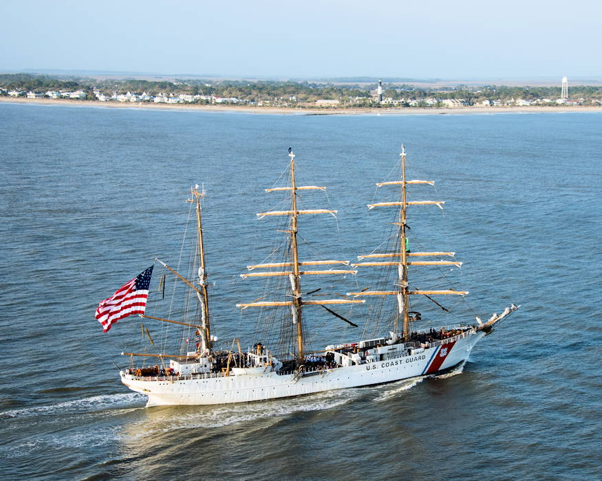 March 15, 2019 - U.S. Coast Guard Cutter Eagle transits down the Savannah River in front of the Tybee Island Lighthouse on its way to Savannah, Georgia The Eagle arrived in Savannah for St. Patrick's Day weekend with over 100 guests on board. (U.S. Coast Guard photo by Petty Officer 3rd Class Ryan Dickinson)