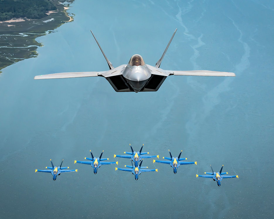 April 25, 2019 - In a historic moment for aviation, the U.S. Air Force F-22 Raptor Demonstration Team flew alongside the U.S. Navy Blue Angels in a rare formation over the skies of Beaufort, South Carolina. The two aerial demonstration teams joined together during the Marine Corps Air Station Beaufort air show to showcase never-before-seen images of both the F-22 Raptor and F/A-18 Hornet. (U.S. Air Force photo by 2nd Lt. Samuel Eckholm)