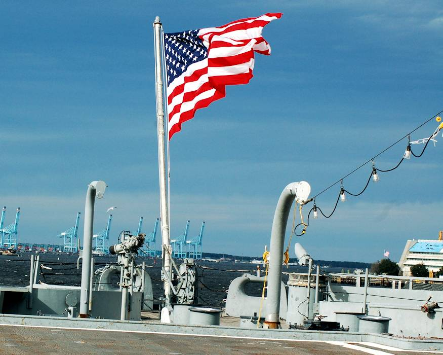 January 1, 2019 - The United States Ensign flies proudly in the brisk wind on the first day of 2019 aboard the USS Wisconsin, an Iowa-Class Battleship that is moored permanently next to the Hampton Roads Naval Museum and Nauticus in Downtown Norfolk, Virginia as a museum ship. The Wisconsin is a popular venue for military ceremonies throughout the year, and is available through the Naval Museum to area commands without cost for this purpose. (U.S. Navy photo by Max Lonzanida)