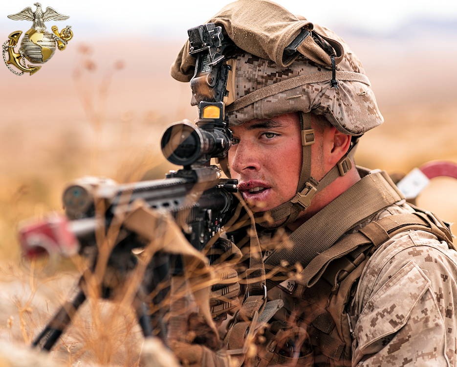 July 25, 2019 - A U.S. Marine with 3rd Battalion, 7th Marine Regiment, 1st Marine Division, sights in on a target during counter improvised explosive device training at Marine Corps Air Ground Combat Center, Twentynine Palms, California. The training was designed to improve the confidence and proficiency in the skill sets Marines and sailors need to operate in an urban environment. (Image created by USA Patriotism! from U.S. Marine Corps photo by Lance Cpl. Colton Brownlee)