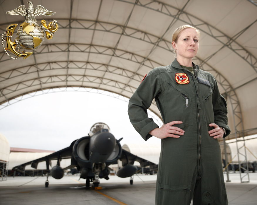 March 27, 2019 - U.S. Marine Corps Capt. Kelsey Casey (30) stands in front of an AV-8B Harrier at Marine Corps Air Station Yuma, Arizona. She is the only female AV-8B Harrier pilot in the Marine Corps. She is currently on deployment with Marine Attack Squadron 311 to the Middle East, as part of Special Purpose Marine Air-Ground Task Force – Crisis Response – Central Command that is involved with coalition operations against ISIS and other terrorist organizations. She will begin training on the new Joint Strike Fighter, the F-35B Lightning II after her deployment. (Image created by USA Patriotism! from U.S. Marine Corps photo by Staff Sgt. Bryan Nygaard)