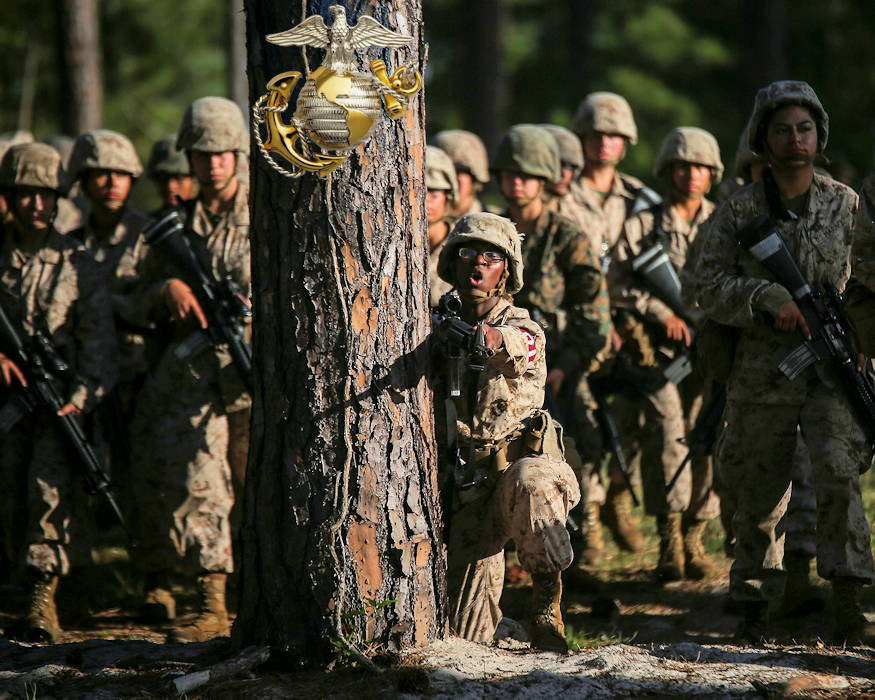 April 17, 2019 - U.S Marine Corps recruits with Papa Company, Fourth Recruit Training Battalion prepare to do the Day Movement Course during Basic Warrior Training (BWT) at Paige Field on Parris Island, SC. BWT is a week-long training event that teaches recruits the basics of combat survival and advanced rifle maneuvers. (Image created by USA Patriotism! from U.S. Marine Corps photo by Sgt. Dana Beesley)