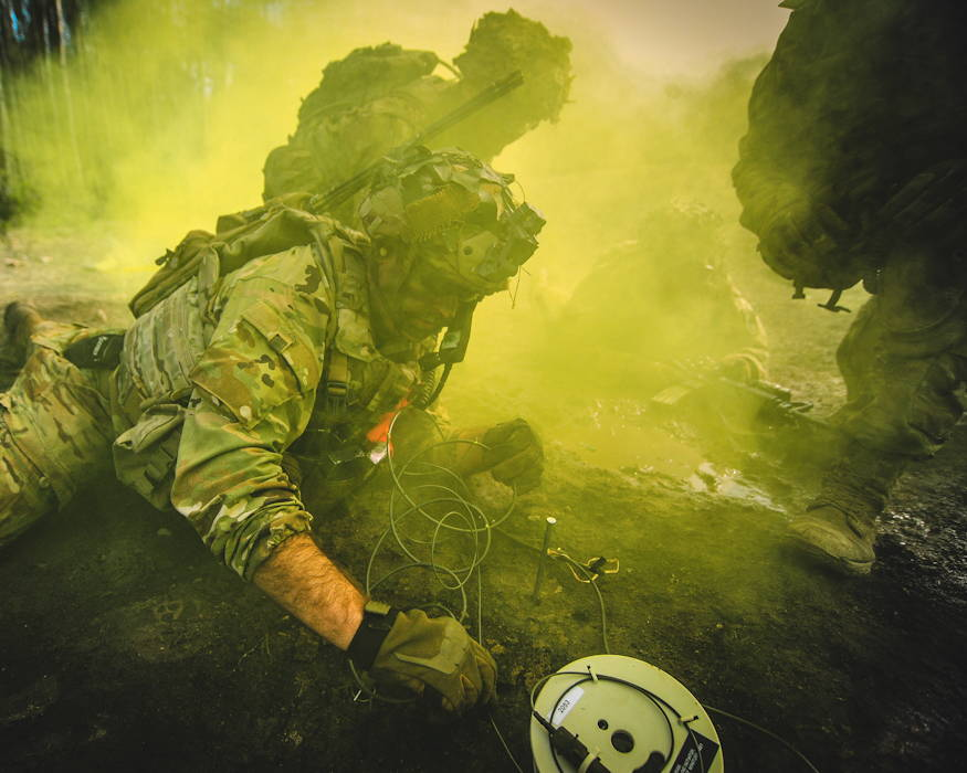 March 6, 2019 - A U.S. Army paratrooper prepares to place an explosive as fellow paratroopers provide assistance in a cloud of smoke at the Grafenwoehr Training Area in Germany during Rock Spring, an exercise that includes air, armor and infantry assets. (U.S. Army photo by Sgt. Henry Villarama)