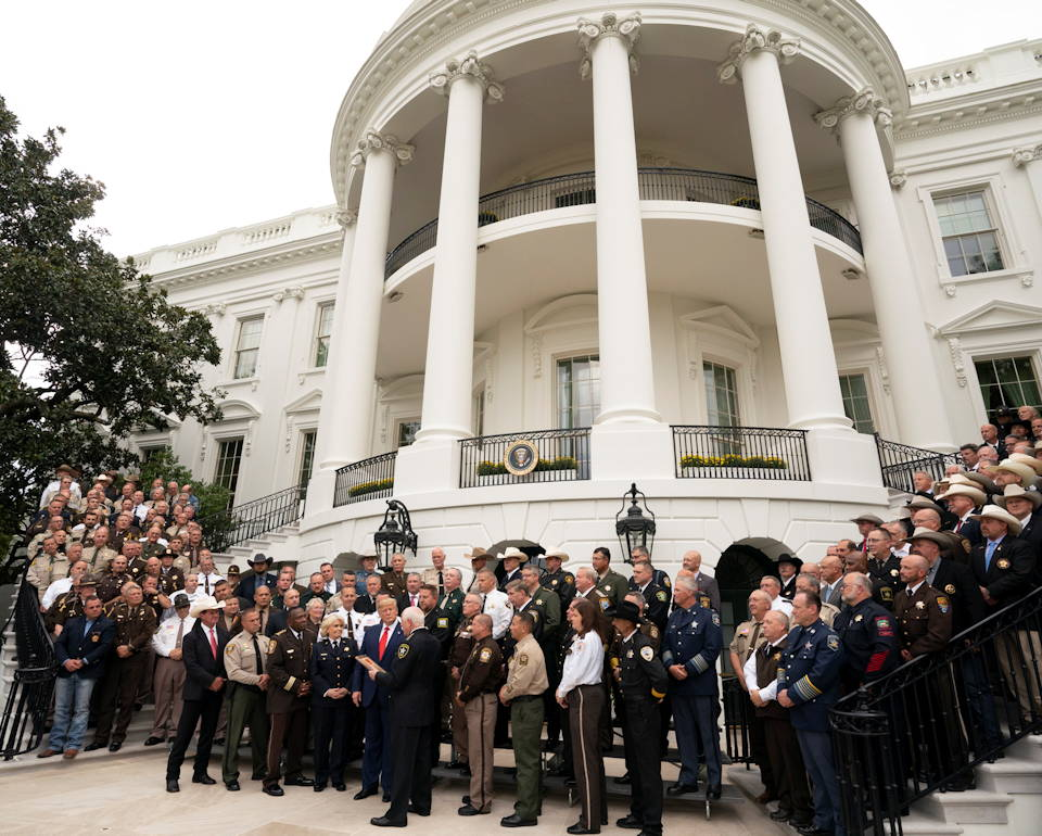 "September 26, 2019 - President Donald J. Trump is presented with a plaque of recognition by ""The Nation's Sheriffs"" from Sheriff Thomas Hodgson of Bristol County, Massachusetts as fellow sheriffs from other parts of the country proudly watch at the South Portico of the White House. (Image created by USA Patriotism! from Official White House photo by Joyce N. Boghosian)"