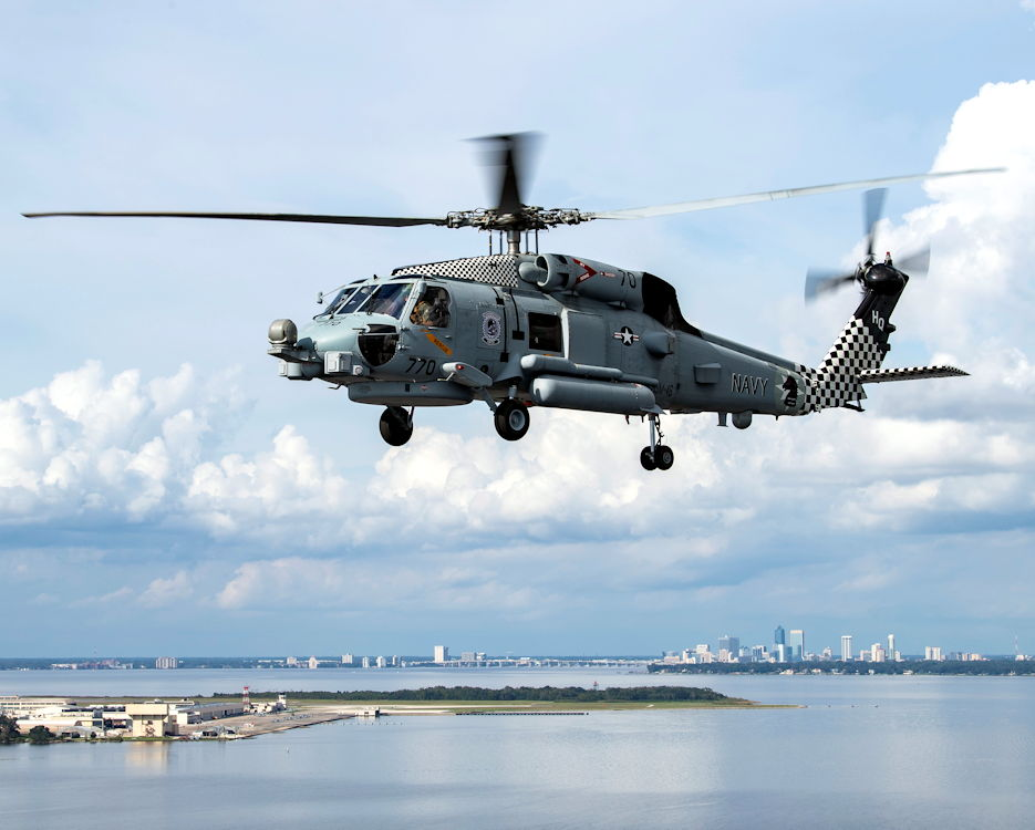 "October 30, 2019 - A MH-60R Sea Hawk helicopter, assigned to the ""Grandmasters"" of Helicopter Maritime Strike Squadron (HSM) 46 stationed at Naval Station Mayport, flies over Jacksonville, Florida. (Image created by USA Patriotism! from U.S. Navy photo by Mass Communication Specialist 3rd Class Nathan T. Beard)"