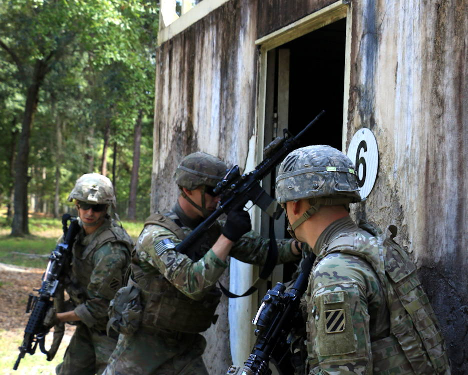 August 21, 2019 - Soldiers from Alpha Company, 3rd Battalion, 15th Infantry Regiment, 2nd Armored Brigade Combat Team, breach an entry point of a building during Battle Drill VI at Fort Stewart, Georgia. After breaching, Soldiers must enter and clear as quickly as possible to ensure a successful takeover. (U.S. Army photo by Spc. Jordyn Worshek)