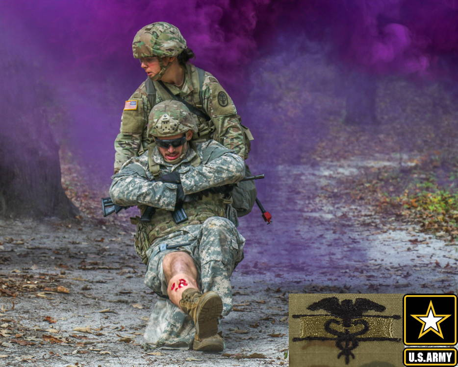 October 29, 2019 - U.S. Army 1st Lt. Savanah Gideon, a combat medic assigned to the Womack Army Medical Center, conducts a cradle-drop drag with a fellow soldier casualty during the Expert Field Medical Badge qualification course. The candidates navigated through the lane to bring their casualties to designated evacuation points. (Image created by USA Patriotism! from U.S. Army photo by Spc. Alleea Oliver)