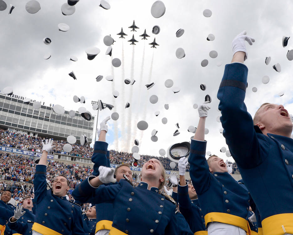 May 30, 2019 - U.S. Air Force Academy Class of 2019 graduates toss their hats skyward as the U.S. Air Force Thunderbirds roar overhead during the graduation ceremony in Colorado Springs, Colorado. During the ceremony 989 cadets crossed the stage to become the Air Force's newest second lieutenants. (U.S. Air Force photo by Darcie L. Ibidapo)