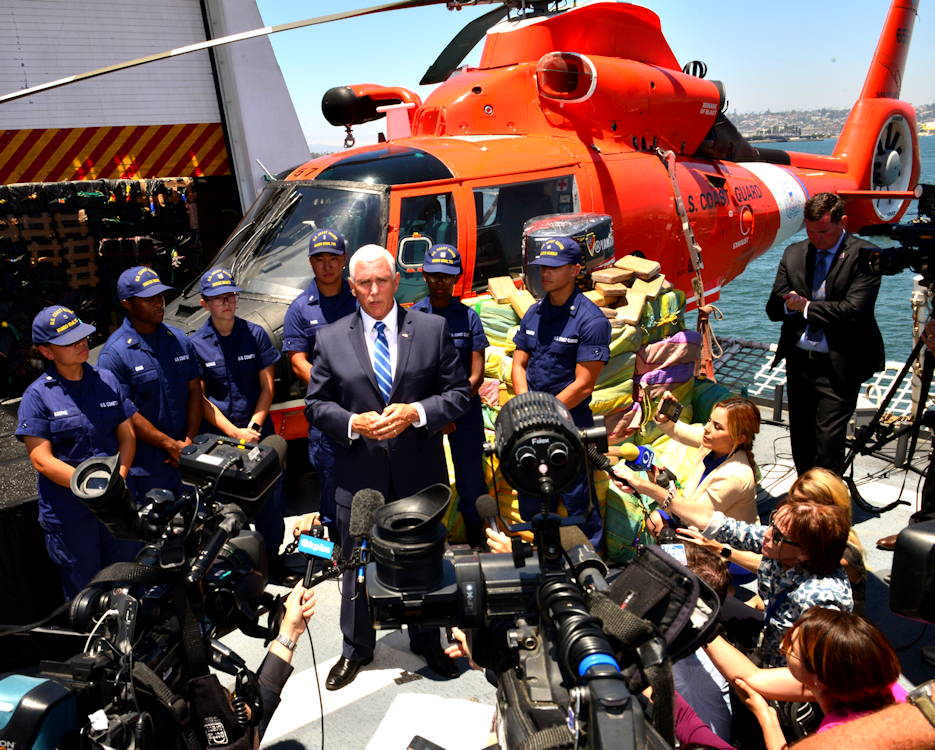 July 11, 2019 - Vice President Mike Pence speaks to reporters from aboard the U.S. Coast Guard Cutter Munro (WMSL 755) in San Diego, California during Munro's bulk offload of more than 39,000 pounds of cocaine and 933 pounds of marijuana that is worth a combined estimated $569 million. (Image created by USA Patriotism! from U.S. Coast Guard photo by Petty Officer 1st Class Matthew S. Masaschi)