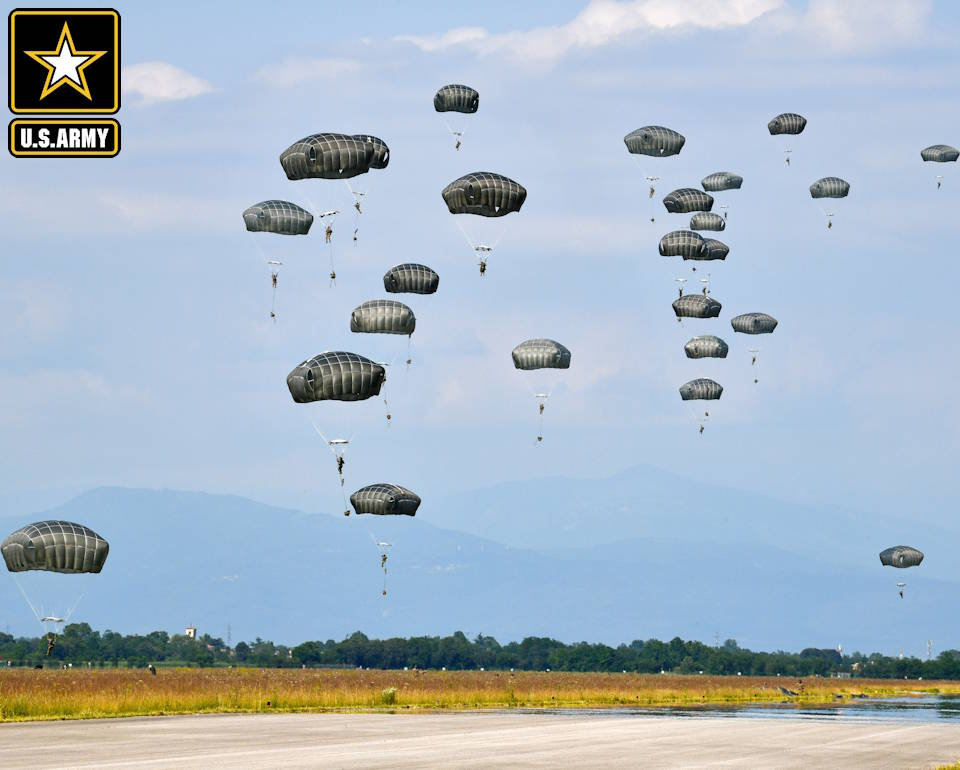 June 24, 2020 - After months of restriction, due to Covid-19, U.S. Army Paratroopers assigned to 2nd Battalion, 503rd Infantry Regiment, 173rd Airborne Brigade prepare to land after exiting U.S. Air Force 86th Air Wing C-130 Hercules aircraft at Rivolto Italian Air Force Base, Udine Italy. (Image created by USA Patriotism! from U.S. Army photo by Paolo Bovo)