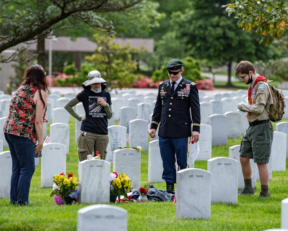 May 25, 2020 - Family members visit the gravesite of their fallen loved one on Memorial Day in Section 60 of Arlington National Cemetery, Arlington, Virginia. (Image created by USA Patriotism! from U.S. Army photo by Elizabeth Fraser)