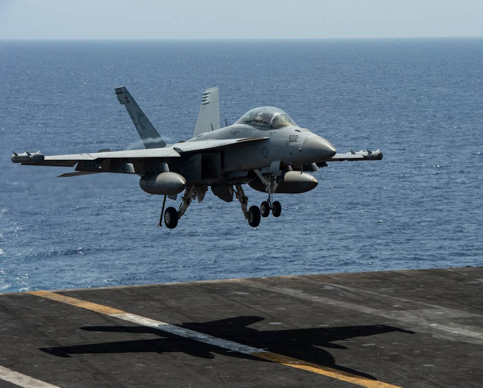 "July 29, 2020 - An E/A-18G Growler, attached to the ""Zappers"" of Electronic Attack Squadron 130, prepares to land aboard the Nimitz-class aircraft carrier USS Dwight D. Eisenhower in the Mediterranean Sea. (Image created by USA Patriotism! from U.S. Navy photo by Mass Communication Specialist 2nd Class Elizabeth Cohen)"