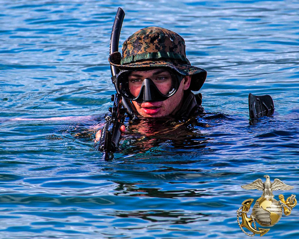 April 28, 2020 - A U.S. Marine approaches the shore rifle ready after swimming deep water during an amphibious assault exercise on Marine Corps Base Hawaii. (Image created by USA Patriotism! from U.S. Marine Corps photo by Lance Cpl. Jacob Wilson)