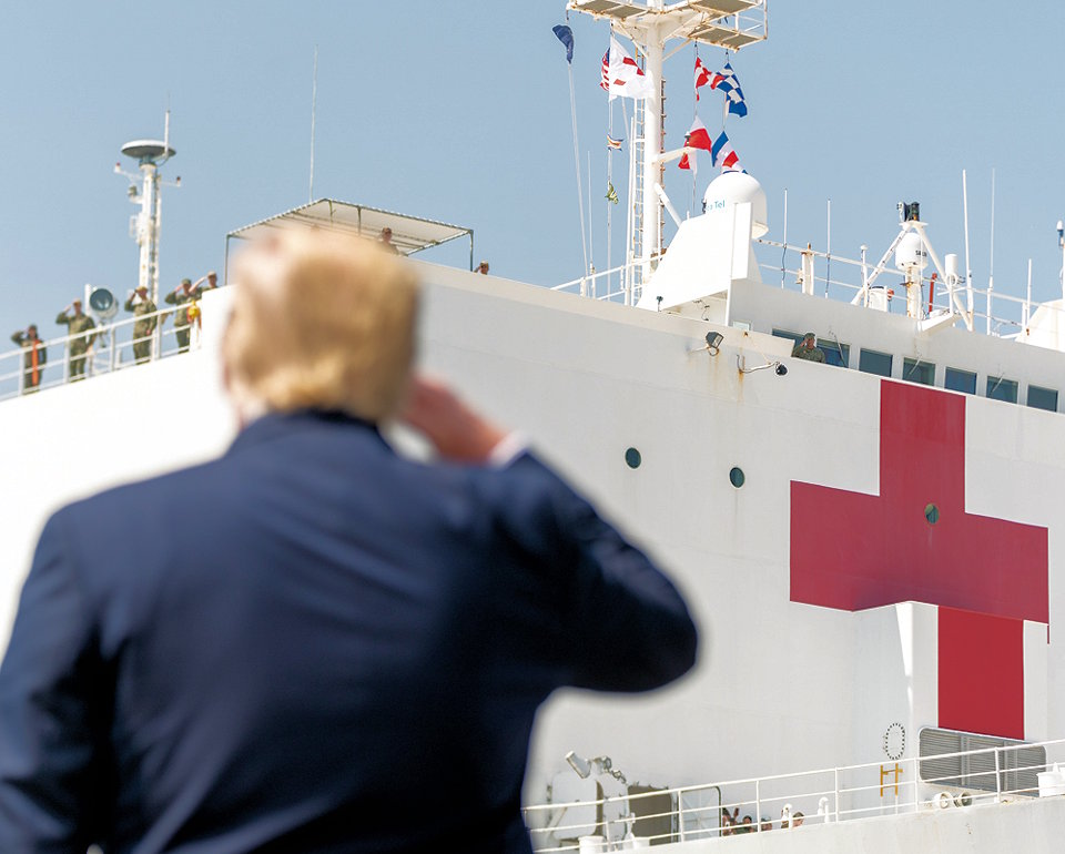 March 28, 2020 - President Donald J. Trump salutes the USNS Comfort and troops on her deck as the hospital ship departs Naval Air Station Norfolk Pier 8 in Norfolk, Virginia en route to New York City in support of the nation's COVID-19 response efforts. (Image created by USA Patriotism! from Official White House photo by Shealah Craighead)