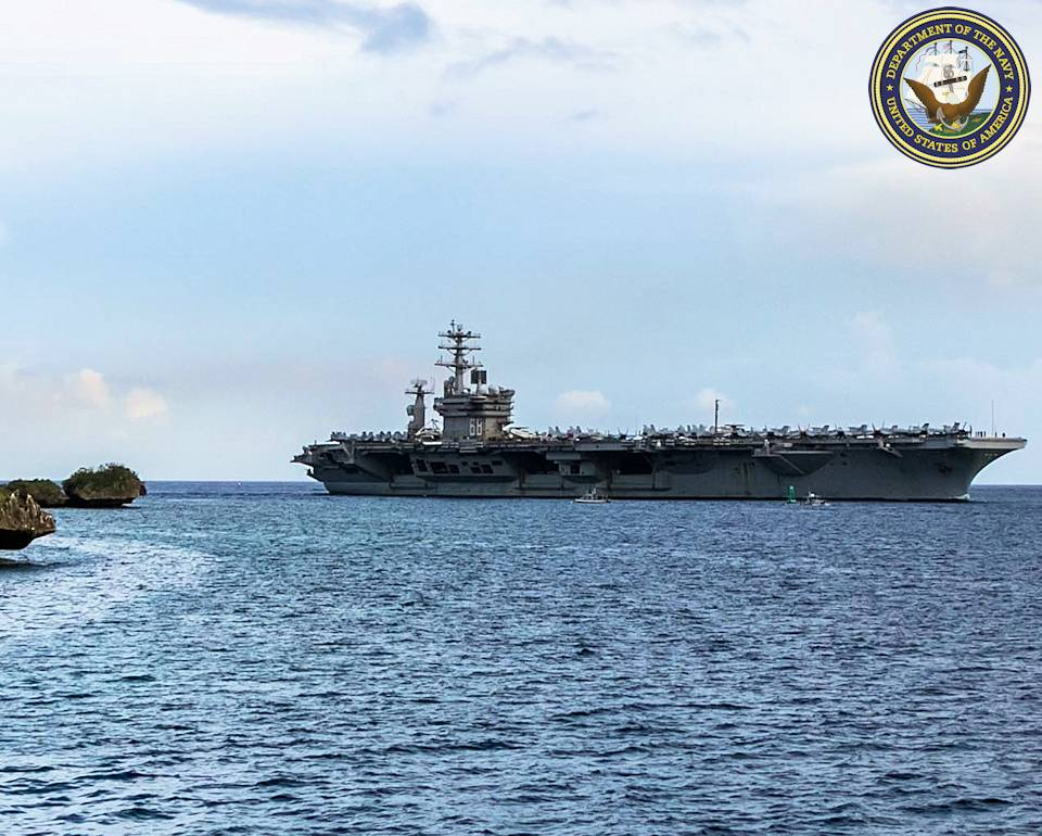 June 24, 2020 - The aircraft carrier USS Nimitz (CVN 68) enters Apra Harbor prior to mooring at Naval Base Guam for a scheduled port visit. Nimitz, the flagship of Carrier Strike Group 11, is deployed conducting maritime security operations and theater cooperation efforts. (Image created by USA Patriotism! from U. S. Navy photo by Chief Mass Communication Specialist Matthew R. White)