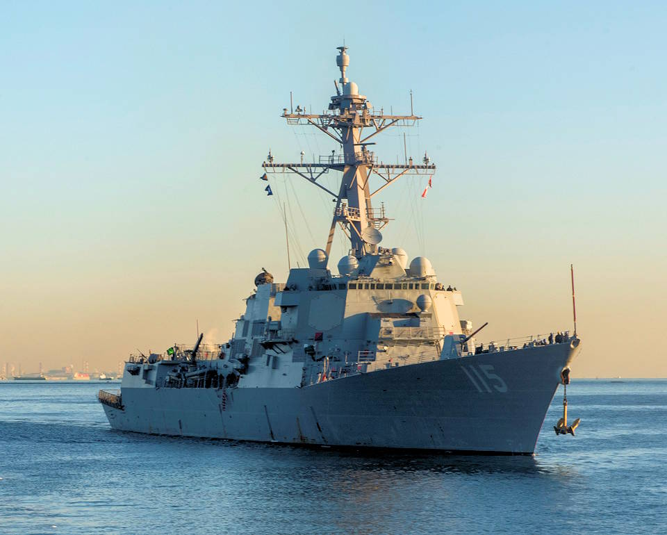 February 4, 2021 - The Arleigh Burke-class guided missile destroyer USS Rafael Peralta (DDG 115) arrives at Fleet Activities Yokosuka after completing a homeport change from San Diego, Calif., to join U.S. 7th Fleet. (Image created by USA Patriotism! from U.S. Navy photo by Mass Communication Specialist 2nd Class Tyler R. Fraser.)