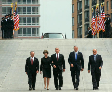President George W. Bush and Laura Bush walk with New York City Mayor Michael Bloomberg, far left, New York Governor George Pataki, second from right, and former New York City Mayor Rudolph Giuliani down the entrance ramp to Ground Zero at the World Trade Center site in New York City Sunday, Sept. 10, 2006.