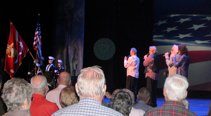 The Oak Ridge Boys lead veterans, troops, loved ones, and fellow patriots in the singing of the National Anthem to start Branson Veterans Week in the Mansion Theatre on November 5, 2009.
