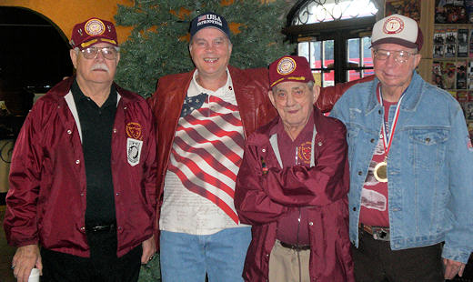 David Bancroft, USA Patriotism! founder, proudly stands with Korean War veterans and survivors of the Sunchon Tunnel Massacre (L-R) Ed Slater, Walt Whitcomb, and Sherman Jones at the Korean War Veterans reunion during Branson's Veterans Week. (Photo by USA Patriotism!)