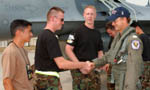 Gary Sinise shaking hands with USAF servicemen