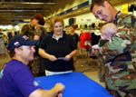 Gary Sinise with a troop and his family