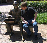 Matt Fitzgibbons sitting next to Thomas Jefferson's statute (Williamsburg, VA)