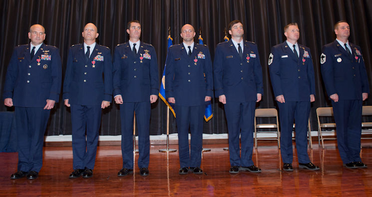 November 21, 2017 - U.S. Air Force airmen... Col. Rhett Champagne, Lt. Col. Blaine Baker, Lt. Col. Robert Rayner, Maj. Jacob Becker, Capt. Andrew Schnell, Chief Master Sgt. Ricky Smith and Senior Master Sgt. Christopher Wright ... stand during a Bronze Star Medal presentation ceremony at Joint Base McGuire-Dix-Lakehurst, New Jersey. During their recent deployments in support of Operation Inherent Resolve in Iraq and Northern Syria, the Airmen led Air Base Opening operations that enabled coalition forces to maintain and extend the range and persistence of counter-Islamic State group operations that sustained coalition forces conducting offensives that led to the elimination of IS in key regions and territories. (U.S. Air Force photo by Tech. Sgt. Gustavo Gonzalez)
